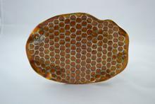 Honeycomb pattern plate