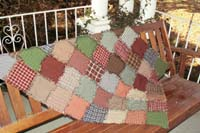 Rag quilt throw over a patio swing