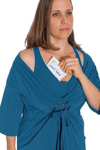 The Recovery Brobe in Blue is designed for women undergoing any breast surgery such as mastectomy, reconstruction, breast augmentation or reduction. Inside the robe are pockets on either side to hold post-operative fluid drains. The front velcro closure bra also has pockets built inside to hold ice packs and/or a prosthetic breast.