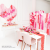 Inspiration: make a heart-shaped crepe backdrop or a photo backdrop using Swoon's crepe streamers. Note: to create this size backdrop, order 3 more sets of streamers. Photo credit: One Stylish Party