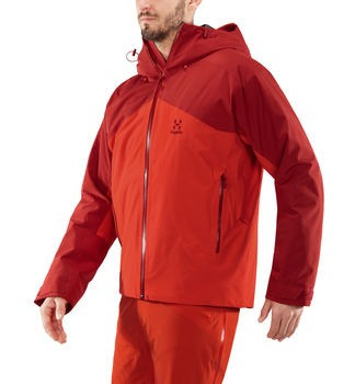 haglofs niva insulated jacket men's ski jacket in rubin habanero worn by model