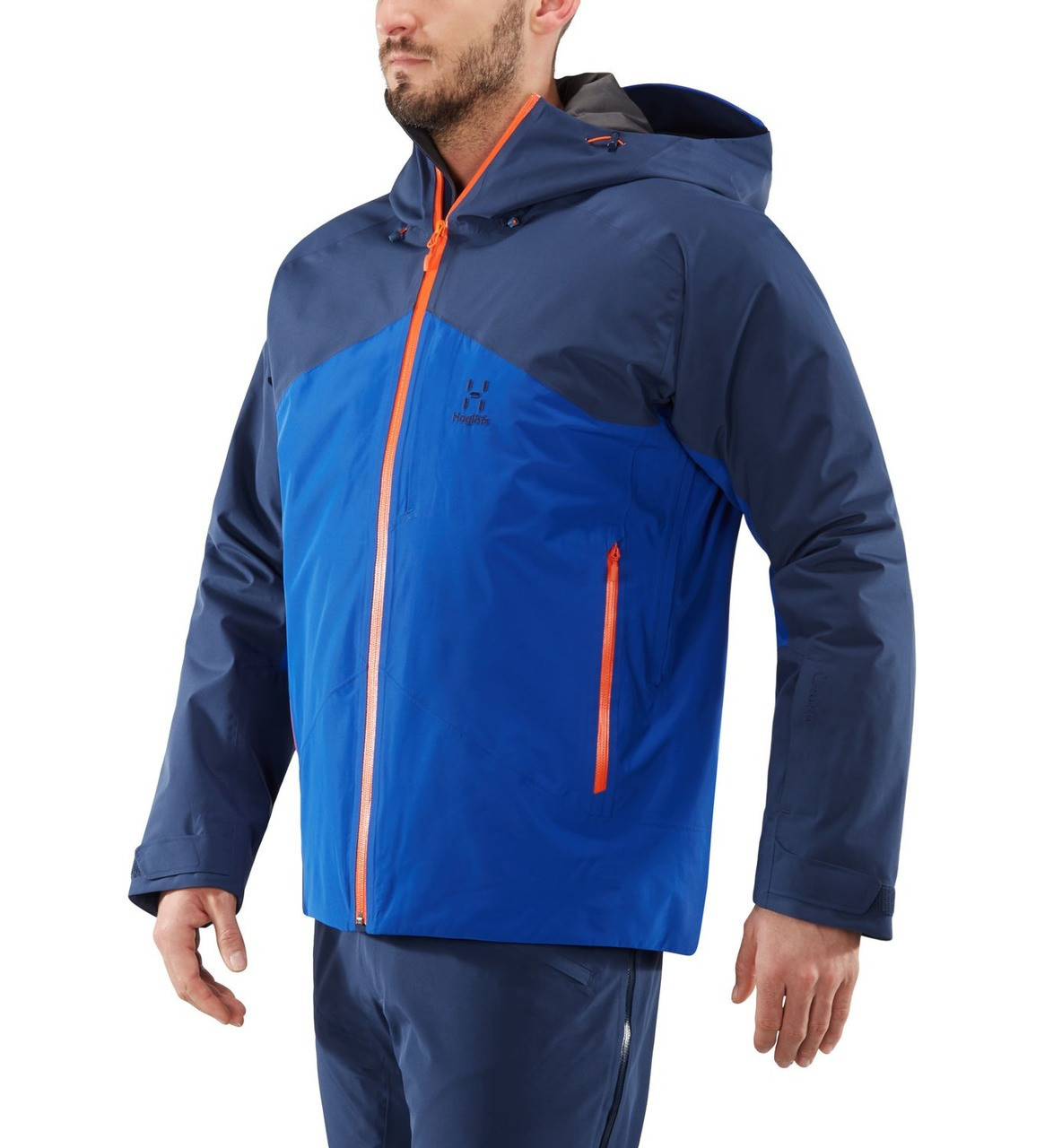 haglofs niva insulated jacket men's ski jacket in tarn blue cobalt blue worn by model