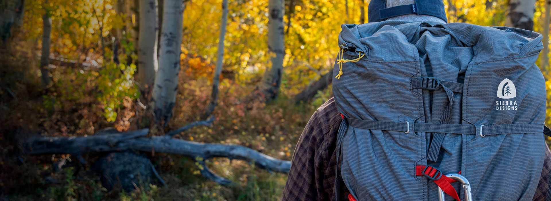 Man wearing a Sierra Designs Flex Capacitor backpack in the forest