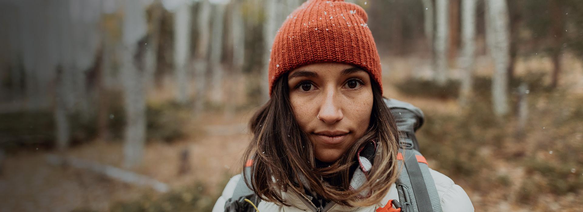 Woman in the woods wearing a Sierra Designs jacket