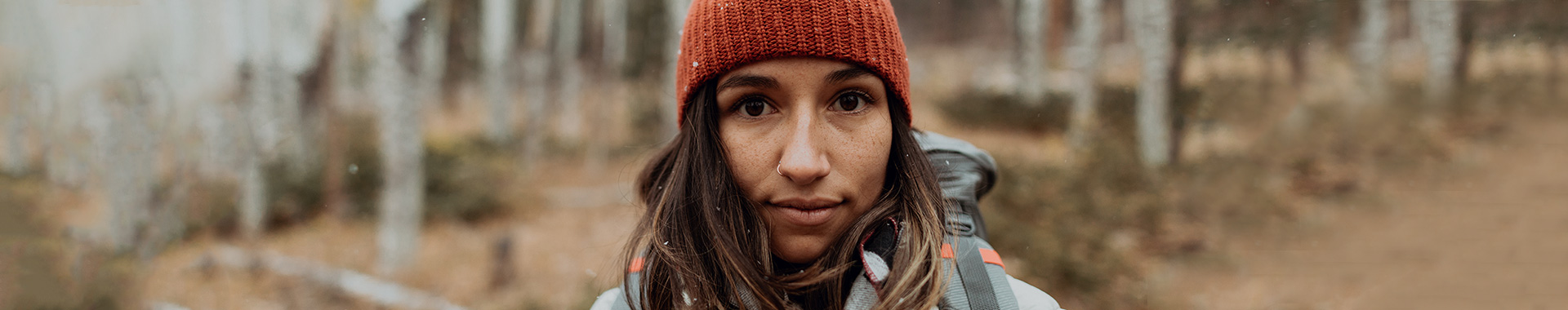 Woman wearing a Sierra Designs jacket in the forest