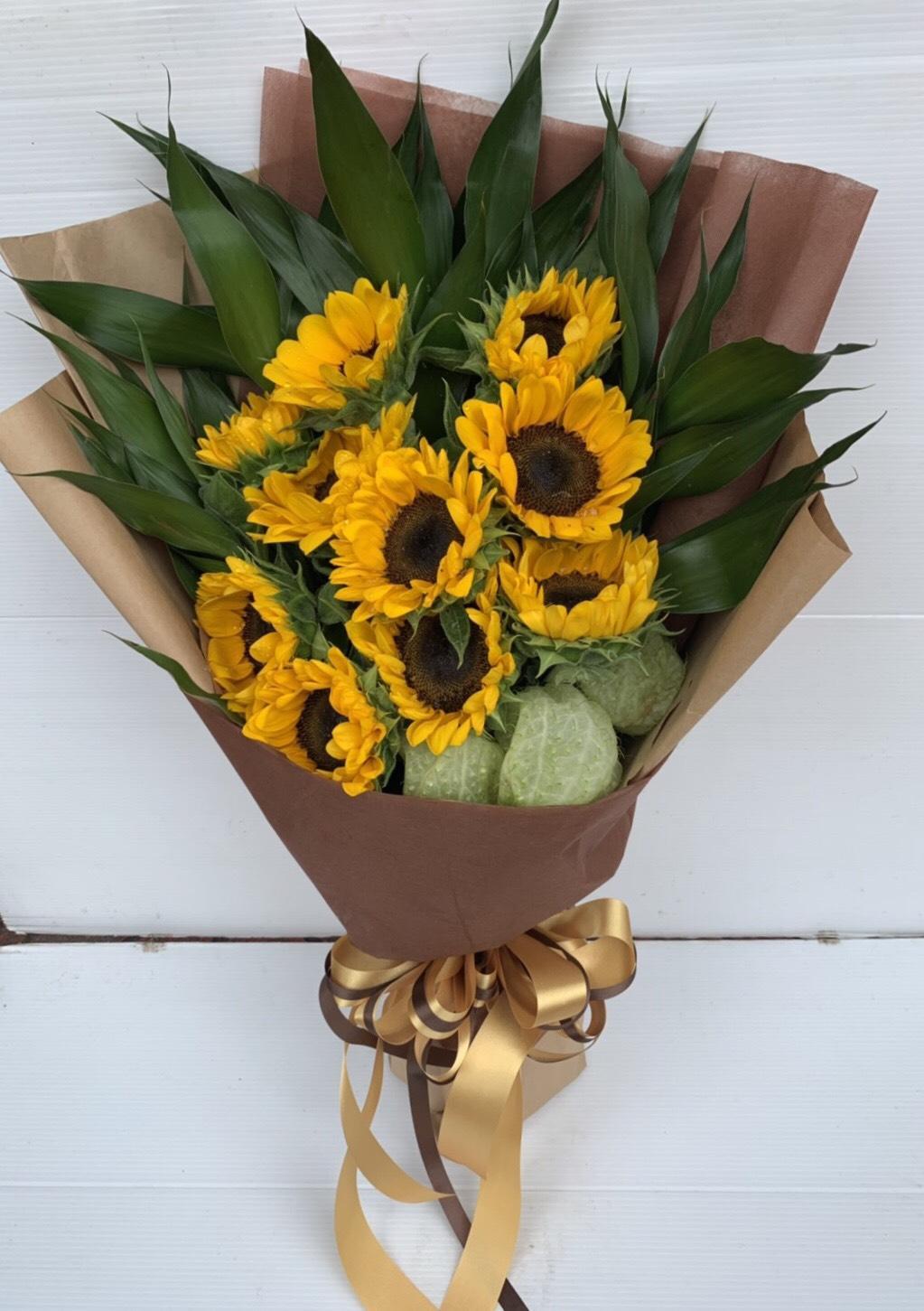 ช่อดอกทานตะวัน ช่อดอกไม้ที่เสริมสร้างกำลังใจในยามท้อแท้ให้กับคนสำคัญ