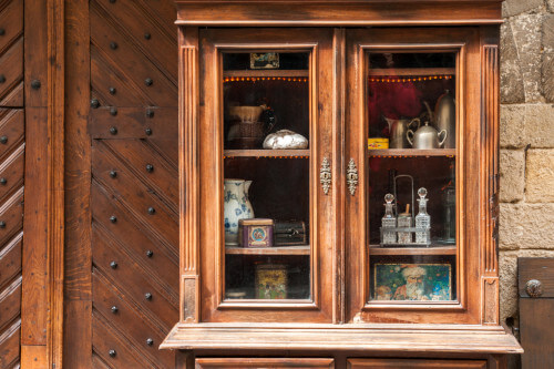antique wood furniture with glass panes
