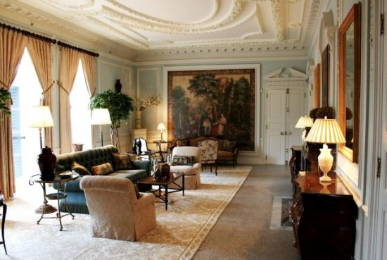 traditional drawing room furnished with antiques