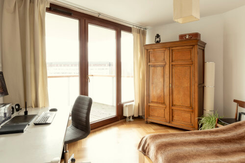 modern room with a large wooden armoire