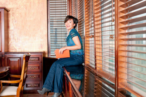 woman sitting on wooden furniture