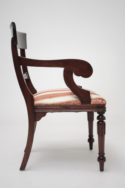 Side view of armchair showing beautiful scroll arms and curved back