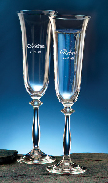 Custom 7oz champagne flutes imported from Europe and personalized with first names and wedding date