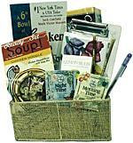 Gift basket arrangement filled with teas, soup, crackers, novelty book, and note paper