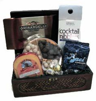 Gift basket arrangement with chocolates, sweet and salty snacks, cheese, confection caramels, dried fruit, and cookies