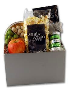 Welcome themed gift basket arrangement filled with fruit, chocolates, sweet and salty snacks,