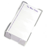 Personalized memo sheets printed with family names and presented in an acrylic holder