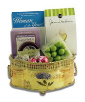Gift basket arrangement filled with chocolate-covered confections, teas, and mints