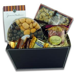 Gift basket arrangement filled with sweet and salty edibles, caramels, chocolate covered fruit,