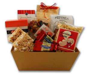 Gift basket arrangement filled with a variety of sweet and salty snacks