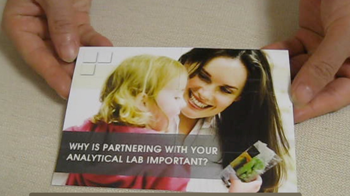 Foldable card exposing four different panels for showcasing products or telling a story