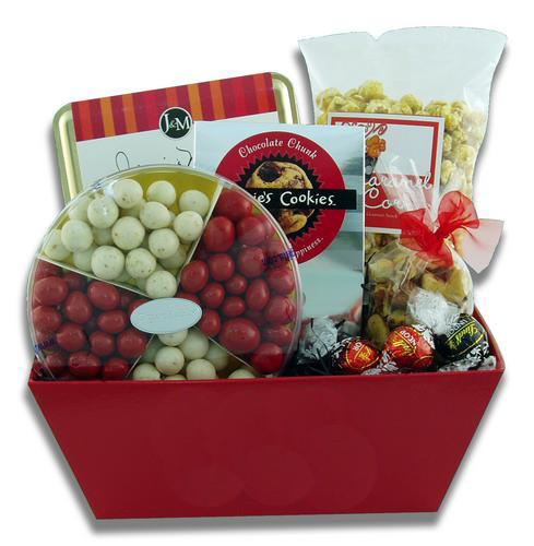 Company color themed gift basket presentation filled with candy, cookies, and other snacks