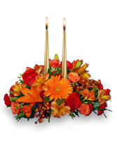 Candle Light Centerpiece.  The warm glow of candles with a great mixture of fall colors for that special fall centerpiece...great way of sharing Thanksgiving with loved ones near of far...Re kindle the tradition of giving thanks.