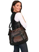 LADIES LEATHER HANDBAG W/IMPRINTED CROCODILE.  ZIP TOP AND OUTSIDE ZIP POCKET.  BUCKLES SNAPS AND RIVET TREATMENT.  ADJUSTABLE SHOULDER STRAP.  IMPORT.
