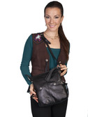 LEATHER HANDBAG AVAILABLE IN BLACK OR BROWN.  TOP ZIP CLOSURE WITH TASSEL ZIPPER PULL.  EXTERIOR FRONT ZIP POCKET WITH TASSEL ZIPPER PULL.  INTERIOR ZIP AND TWO OPEN POCKETS.  EXTERIOR DECORATIVE STRAPS WITH TIE CLOSURE ON BOTH SIDES.  EXTERIOR STUDD