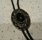 Oval Black Onyx Stone Inlaid in a Oval Antique Silver and Black Frame Bolo Tie