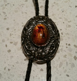 Tiger Eye Stone Inlaid in a Oval Antique Silver and Black Frame Bolo Tie