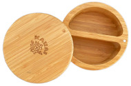 "Salt & Pepper...  Cinnamon & Sugar...  So many of our favorite flavors come in twos! Our Salt Keeper Duet does double duty with two compartments for herbs, spices, seasonings and more. Crafted from organically grown bamboo, this box sports a magnetic swivel lid for easy one-handed opening and closing. Laser engraved ""Kauai"" with plumeria flowers.  Measures 5"" diameter x 2-1/4"" high"