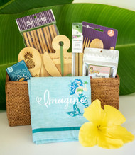 "SKU#GB-7  Gift Basket consists of the following items:  Chambray Mermaid Embroidered Tea Towel Kauai Pineapple Bamboo Rice Paddle  Reusable Bamboo Flatware Set Set of 2 Bamboo reusable Drinking Straws 10 pairs pack of Twisted Bamboo reusable Chopsticks Kauai Lele Espresso Chocolate covered Coffee Beans 2.75oz Big Island Coffee Roasters Classic Espresso Bites 1.5oz Bamboo Spread Da Aloha Cutting Board with spreader    (Pictured Basket not included)  *10.5"" Round Gift Basket included** * Products or items maybe substituted with items of the same value  due to availablity of products."