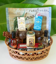 "SKU#GB-11  Gift Basket consists of the following items:  Big Island Espresso Latte Bites 1.05oz bar Big Island Espresso Classic Bites 1.05oz bar Big Island Bee's Honey 3 pack (Willilaiki Blossom, Ohia Lehua Blossom & Macadamia Nut Blossom) 4.5oz jars Oils of Aloha Pele's Fire Mac Nut Oil 5oz jar Oils of Aloha Garlic Isle Mac Nut Oil 5oz jar Set of 2 Coconut wood Wine Goblets Carved Coconut wood Salad Set Hawaiian Gold Mustard 7.5oz jar Magic Slice Gourmet Free Range Rooster Flexible cutting mat  *10.5"" Round Gift Basket included** * Products or items maybe substituted with items of the same value  due to availablity of products."
