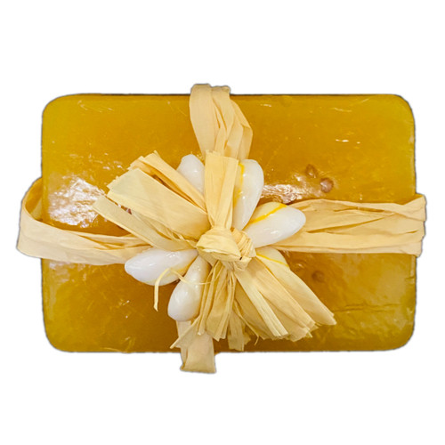 """SKU#226  """"MADE ON KAUAI""""  Banana Soap-3.8oz  Banana Soap is made with Organic Coconut oil and glycerine and scented with Tangerine and Litsea essential oils to smell like fresh bananas.  With a touch of Pikake to remind you of the tropics and include tiny guava seeds from Kauai for gentle exfoliation."""