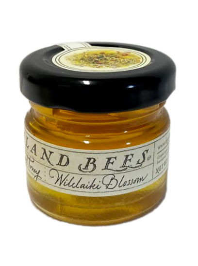 SKU #15  Ingredients: 100% Pure Organic Hawaiian Honey  Also known as Hawaiian Christmas berry, this unique Hawaiian honey is ambrosial with a subtle spicy flavor, liquid texture and light amber color. Recognizable by its festive red berries.  1oz jar