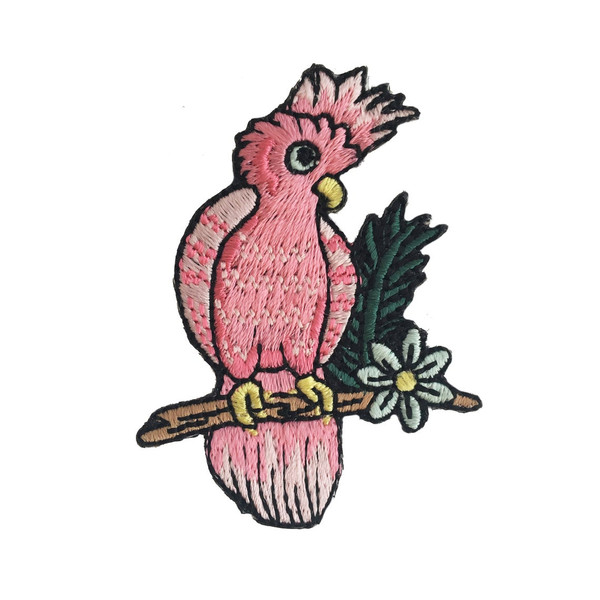 Adorable pink cockatoo parrot is just chillin' & looking cute on her branch. Fully embroidered iron on patch.