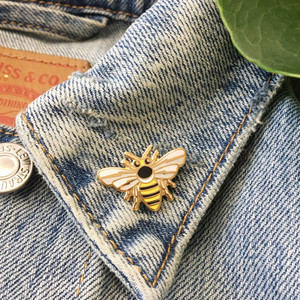 Tiny Bee Enamel Pin - Gold - VSCO Pins - Wildflower + Co. ………………………………….…………………………………. Bee yourself with this adorable, teeny bee pin. Subtle symbols are layered within the bee - wings have lightning bolts & body features a crescent moon. Teeny tiny, just like if a queen bee were to land on you! Perfect size for a collar or anywhere you want a little accent. Hard enamel pin.