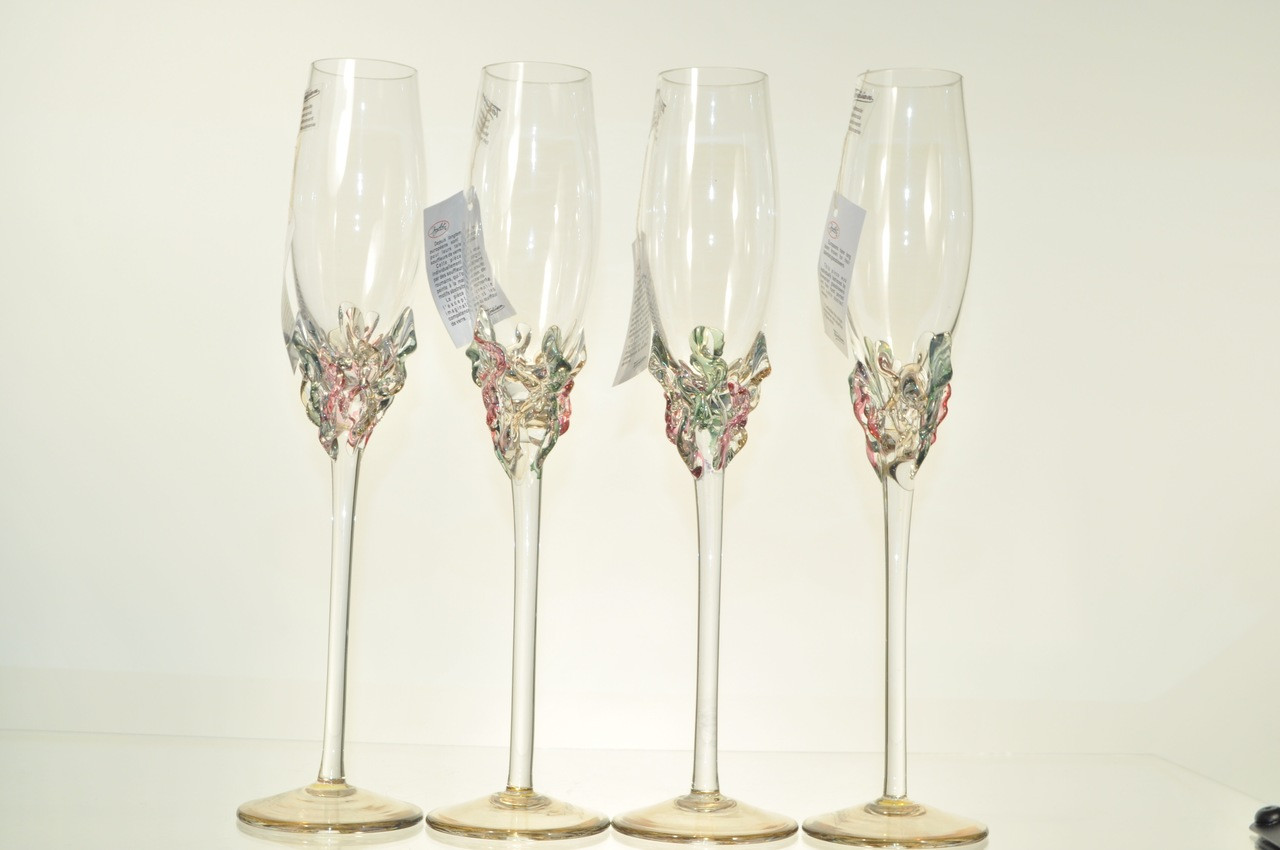 A gorgeous set of champagne flutes hand made by world-renown Art Glass artist Ion Tamaian