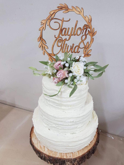 "Elegant Wedding Cake.  Dark Chocolate mud cake with white chocolate ganache.  10"", 8"", 6"" to feed 150 people."