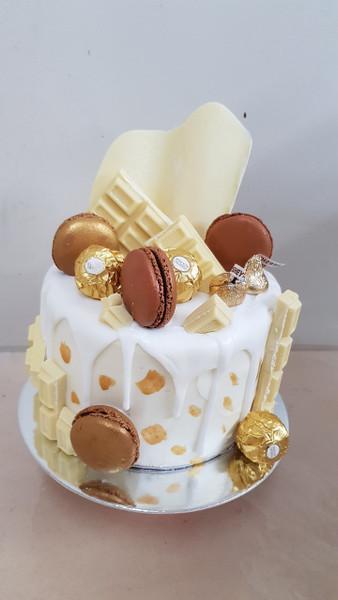 Beautiful White Choc with Macrons Drip cake
