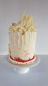 Decadent White Chocolate and Raspberry Buttercream Cake