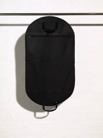 Picture of the outside of a black handled suit cover bag with accessory shirt pocket