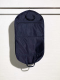 Picture of the front of a nylon handled suit cover with large accessory pocket