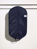 Picture of the inside of a nylon handled suit cover with large accessory pocket