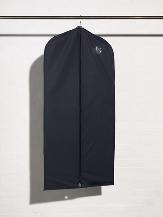 Full length picture of plastic coat and dress cover bag