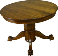 SOLD Round Oak Claw Foot Dining Table with 2 Leaves