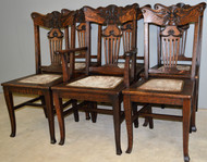 SOLD  Set of 6 Oak Unusual Carved Face Dining Chairs