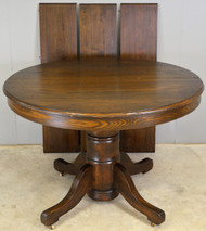 SOLD Round Oak Table with 3 leaves – 1910s