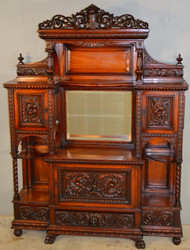 SOLD  Mahogany Herter Style Heavily Carved Etagere
