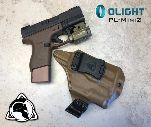 """Weapon Mounted Light Carry System shown.  Does not include Magazine Extension. Rare Earth Magnet Retention Holster for the Glock 43 and the Olight PL-Mini 2.  Shown in Coyote Tan with 1.75"""" Black Belt Clip."""